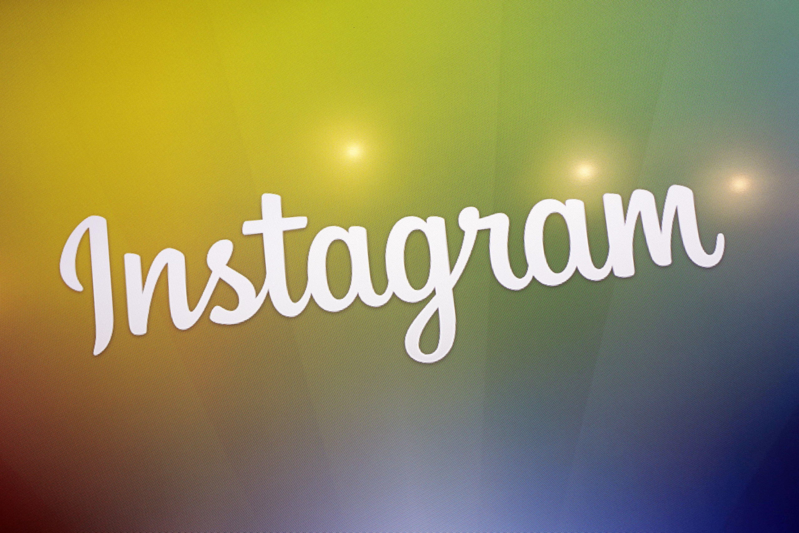 The Instagram logo is displayed on an electronic screen at a news conference, Thursday, Dec. 12, 2013 in New York for the introduction of Instagram Direct. (AP Photo/Mark Lennihan)